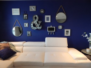 trendy living room with blue walls and white couch
