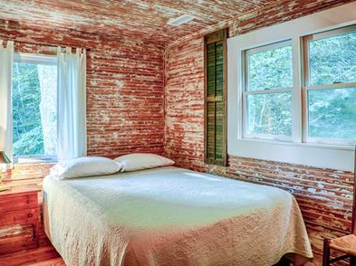 cozy and scenic brick bedroom