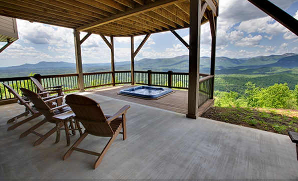 deck with hot tub and beautiful mountain views