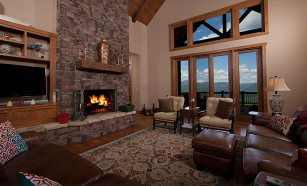 two story family room with fireplace and mountain views