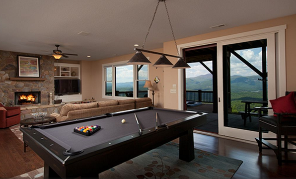 pool table room with fireplace and tv