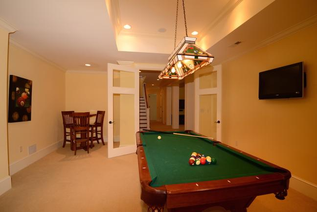 Game room with a pool table.