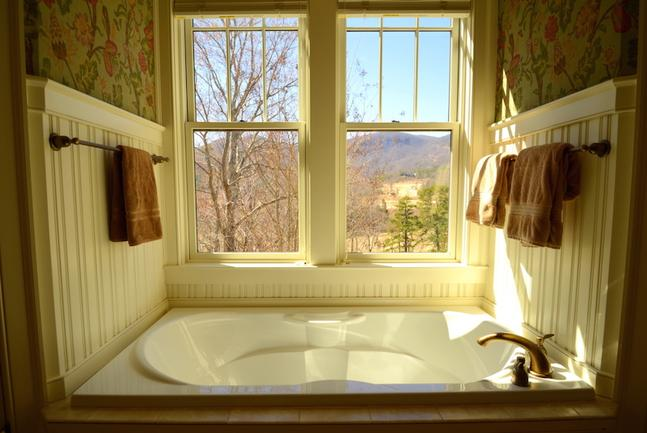 Master bathroom with nice window view.
