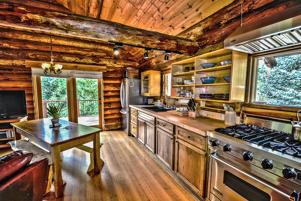 Interior of a wood log cabin with a beautiful stove and shining table.