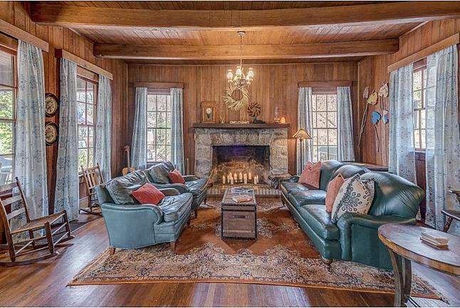 Large family room with a fireplace.