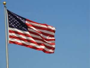 An American Flag rippled in the breeze against a sky background