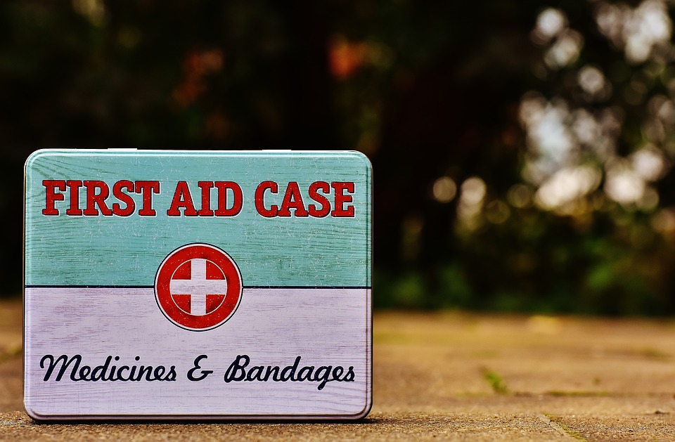 A metal first aid tin.