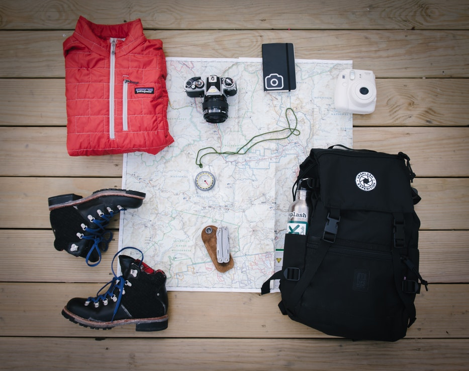 Hiking gear laid out over a map.