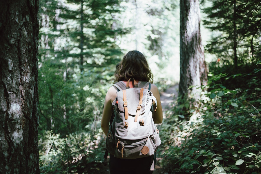 Woman hiking in the forest.