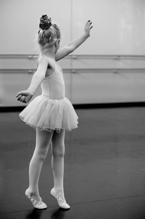 A young girl doing ballet.