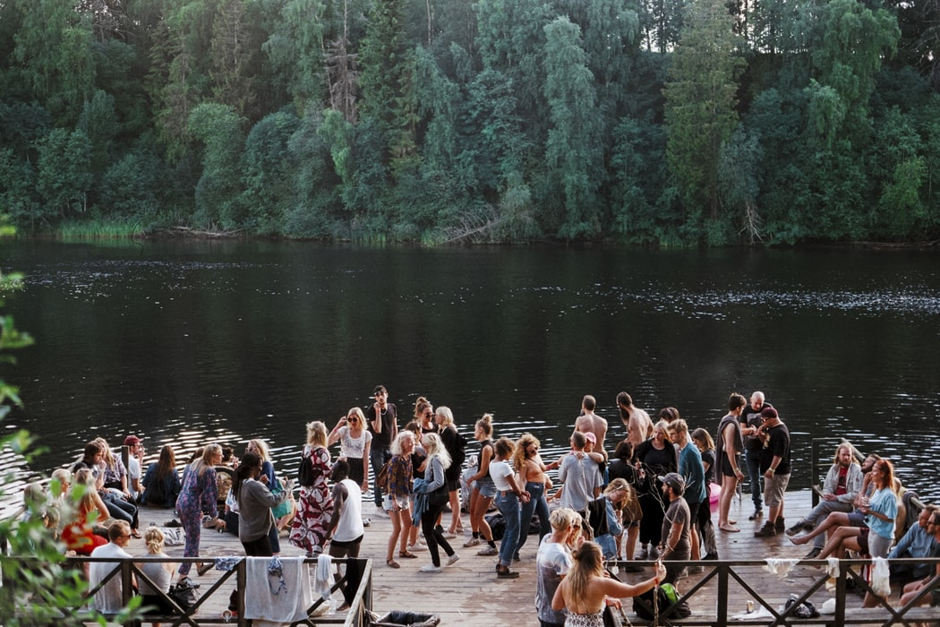 People dancing by a lake.